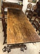 Oak refectory plank top dining table with four rush seated oak ladder back chairs, table approx