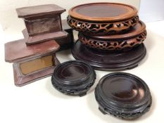 Collection of eight Chinese / Eastern ginger jar bases / vase bases / plinths, five in wood, three