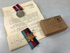 Two WWII medals: The 1939m- 1945 star and the Defence medal unmarked in original box addressed to GW