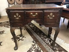 Small writing desk / console table with three drawers and brass fittings on carved legs, approx 74cm