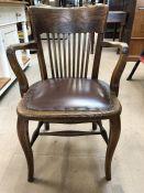 Oak slat-backed elbow chair