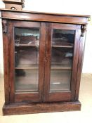 Two door glazed mahogany bookcase with three shelves and original key, approx 92cm x 28cm x 112cm
