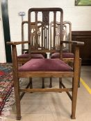 Five oak dining chairs with padded seats, to include one carver