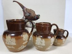 Three Royal Doulton stoneware jugs, the tallest approx 16cm in height, along with a Coalport