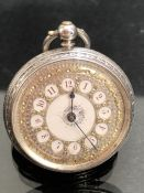 Silver coloured Pocket watch with makers marks Gold gilt face
