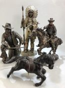 Two cast figurines of John Wayne, the tallest approx 26cm in height, along with a Leonardo