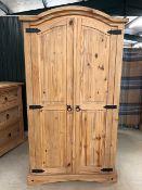Small pine wardrobe with hanging rail and shelf internally, approx 98cm x 55cm x 184cm tall