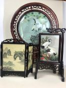 Three Chinese screens, two on silk, all with pierced wooden frames, the largest approx 57cm in