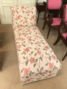 Upholstered chaise longue on castors with floral upholstery, approx 142cm in length