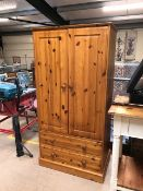 Small pine wardrobe with two hanging rails and two drawers under