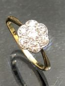 Gold daisy Style ring with seven Diamonds set in Platenum mount.size K.5