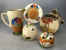 Collection of Clarice Cliff to include Bizarre pattern Biscuit barrell, 2 * preserve pots with lids,