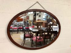 Oval mahogany-framed bevel-edged mirror approx 96cm wide