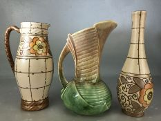 Two items of Bursley Ware Charlotte Rhead ceramics: a jug approx 23cm in height and a vase approx