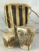 Collection of three skin-covered tribal drums, the tallest approx 34cm in height