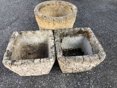 Collection of three small concrete pots