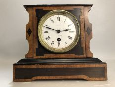 19th Century French mantel clock with enamel dial, in working order, approx 21cm in height