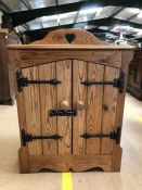 Small pine cupboard with heart detailing to upstand, approx 65cm x 35cm x 73cm tall