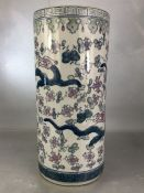 Chinese ceramic stick / umbrella stand with dragon design, approx 45cm in height