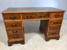 Modern twin pedestal desk with green and gold leather inlay and keys