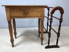 Small pine hall table with drawer and a wooden towel rail
