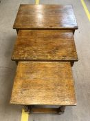 Oak nest of three tables with turned legs, the largest with single drop leaf