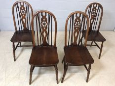 Set of four wheel-back 'Old Charm' chairs