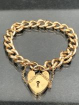 9ct Gold curb link (every link stamped 9ct 375) bracelet with 9ct gold heart shaped lock and