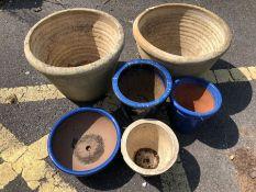 Six assorted stone garden pots