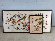 Two framed Oriental / Chinese hand-embroidered pictures, both of birds, the larger approx 104cm x