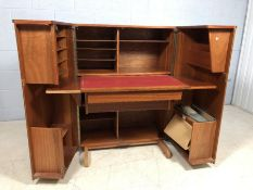 Newcraft 'Home Office' Mid Century teak desk with fold out side cupboards and retractable writing
