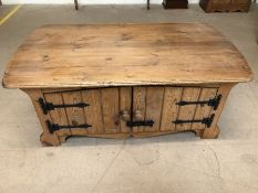Pine coffee table with cupboard storage under, approx 120cm x 67cm x 48cm tall