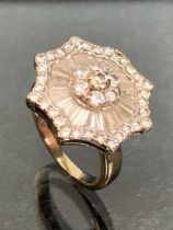 Art Deco Style Starburst Diamond ring with seven diamonds set to the centre in a diasy cluster,