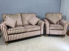 Contemporary two seater sofa with matching armchair and cushions on brass castors