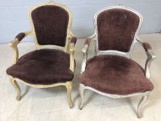 Pair of upholstered and painted bedroom chairs, one cream, one silver