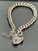Hallmarked silver bracelet (each link stamped) with heart shaped lock (marked stirling silver)