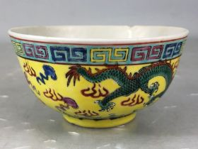 Chinese rice bowl depicting dragons and flaming pearls on a yellow ground A/F
