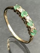 Emerald and diamond half Eternity ring set with four Emeralds and three diamonds on 9ct Gold