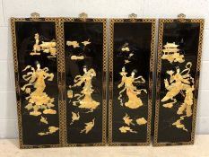 Set of four Oriental black lacquered and mother of pearl inlaid panels, each with figures and