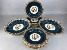 Collection of Old Worcester Parrot to include two oval serving dishes and eleven plates