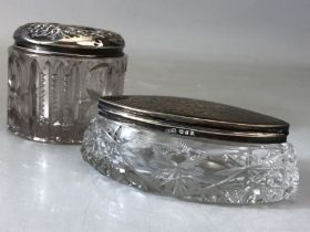 Two Glass and hallmarked silver lidded dressing table pots