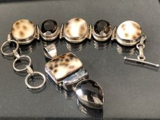 Hallmarked 925 Silver Bracelet and matching Pendant both set with Cowrie shells and faceted smokey