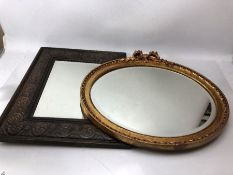 Two bevel edged mirrors with decorative frames, the larger approx 54cm x 44cm