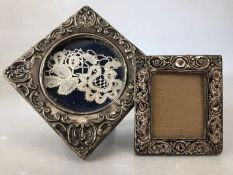 Two silver hallmarked photoframes the larger approx 9cm square both A/F