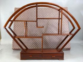 Oriental wooden display stand with multiple shelves and two drawers, height approx 45cm in height