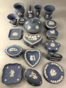Collection of Wedgwood blue ground jasperware decorative items to include pin dishes, vases, a bell,