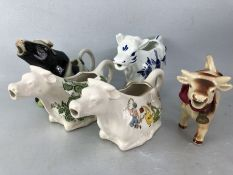 Collection of five pottery cow creamers to include 2 X Crown Devon