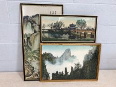Three Oriental / Chinese embroideries of mountainous/temple scenes, the largest approx 84cm x 43cm