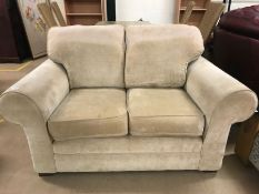 Fawn coloured modern two seater sofa