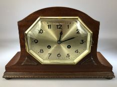 German mantle clock with octagonal bezel in mahogany case, approx 22cm in height